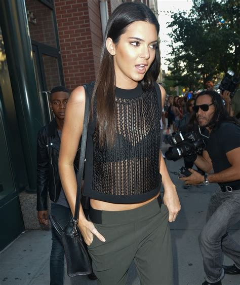 Kendall Jenner Flashes Bra in Boxy Logo Slit Tank and BB Pumps