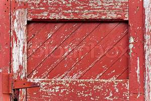 an old worn barn door or wooden fence gate with chipped With barn door red paint