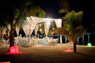 Tropical Wedding Decorations by Beautifully Lighted Beach Wedding At Night