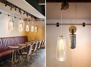 This restaurant is filled with pendant lighting on a