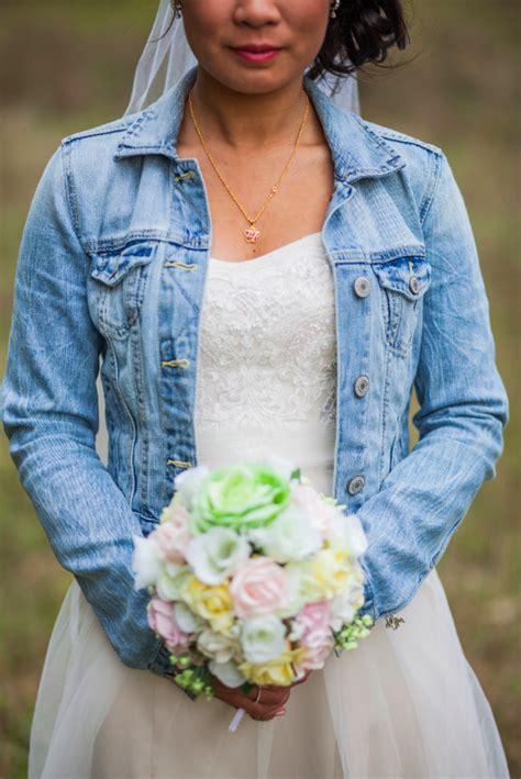 bride bridesmaids  jean jacket  wedding rustic