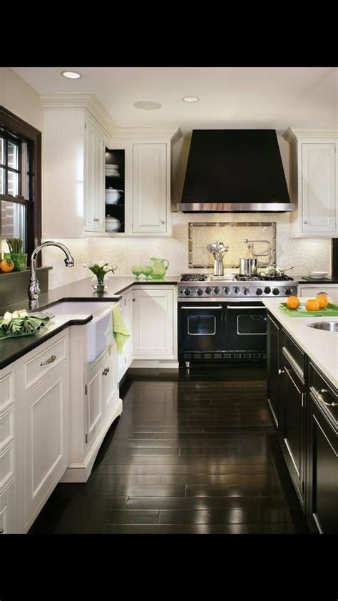 white and dark wood kitchen best 25 black white kitchens ideas on pinterest 656 | 9552b2361796ee31dc6077aadddd2bc2 black hardwood floors dark wood flooring