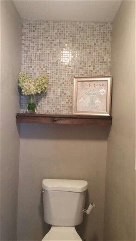 Half bath redo. Mosaic tile, floating shelf, Behr perfect