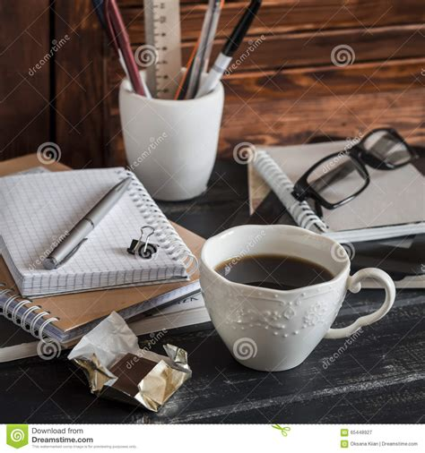 Workplace With Business Objects  Books, Notebooks, Pens, Tablet, Glasses And A Cup Of Coffee