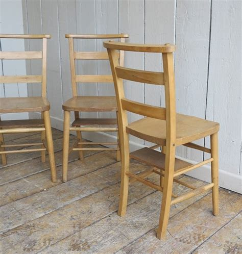 wooden reclaimed church chairs with a bible shelf