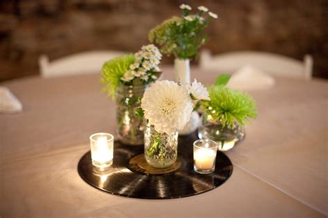 centerpieces using photos music themed wedding julie blanner