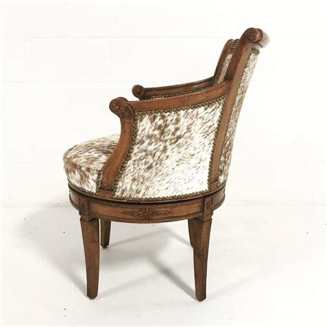 vintage swivel chair in brown and white speckled