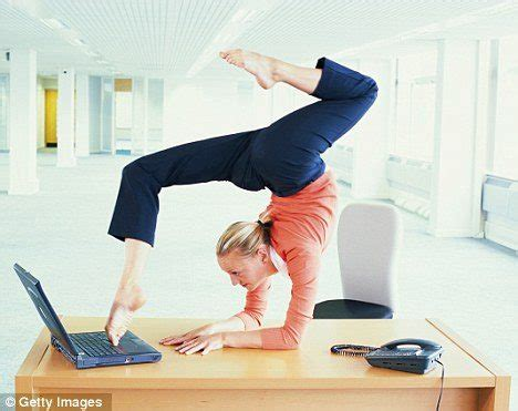 yoga at your desk 15 simple and quick office stretches to boost work efficiency