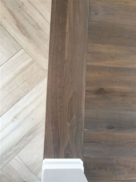 Floor transition // laminate to herringbone tile pattern