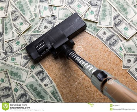 Money On The Floor Vacuuming With Vacuum Cleaner Stock