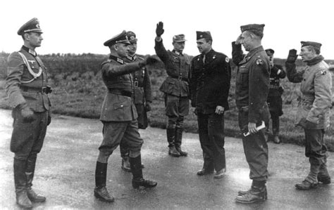 The Officer Giving The Hitler Salute In The Foreground Was In Charge Of The Pow Exchange For The