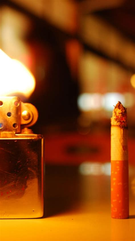 blurred background bokeh cigarettes flames lighters