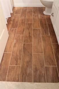 remodelaholic bathroom renovation with wood grain tile and more