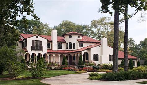 spanish style house stock image image  chimney bush