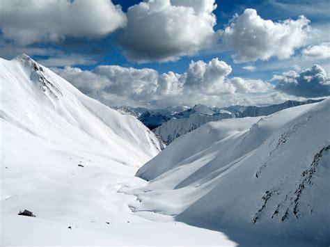 snowy alps wallpaper  wallpaperesque