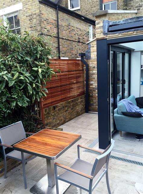 modern garden design brixton patio paving hardwood