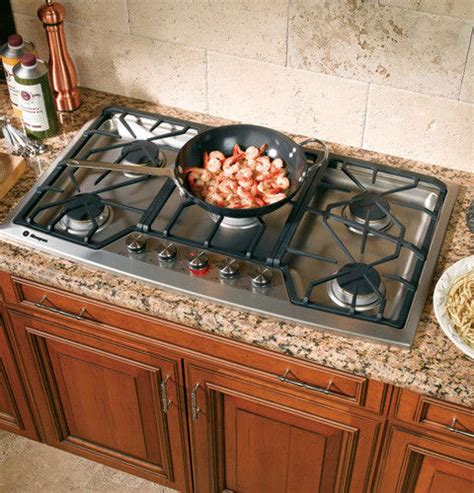 monogram zgunsmss   gas cooktop   sealed dual flame stacked burners  degree