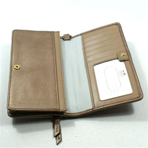 coach embossed leather demi clutch wristlet wallet  coach