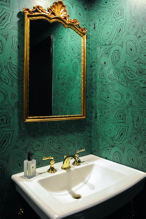 emerald green powder room  gold ornate mirror