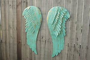 large angel wings wall decor the vintage artistry With kitchen cabinets lowes with metal angel wings wall art