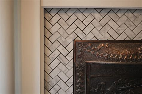 herringbone marble tile fireplace for the home