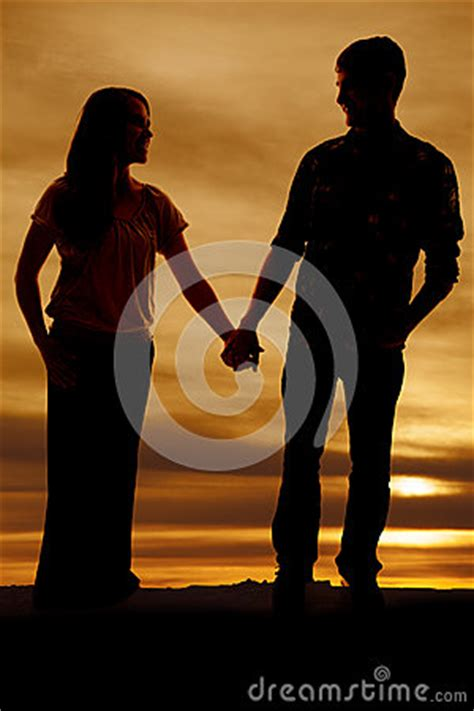 silhouette  man  woman holding hands royalty