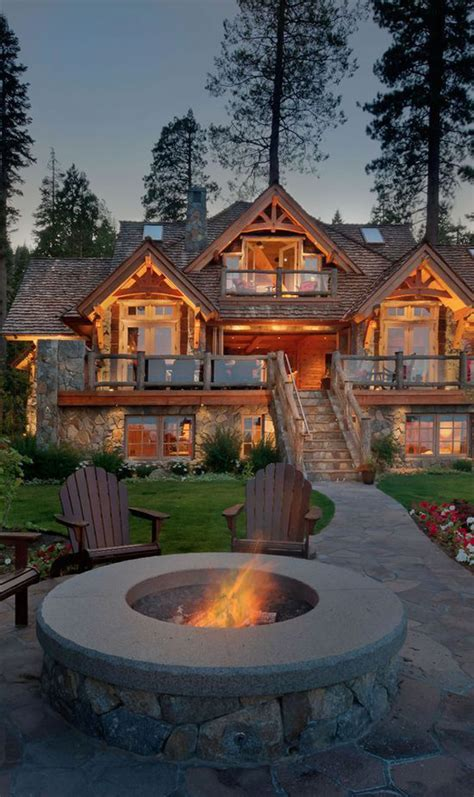 awesome mountain house  outdoor fireplace homemydesign