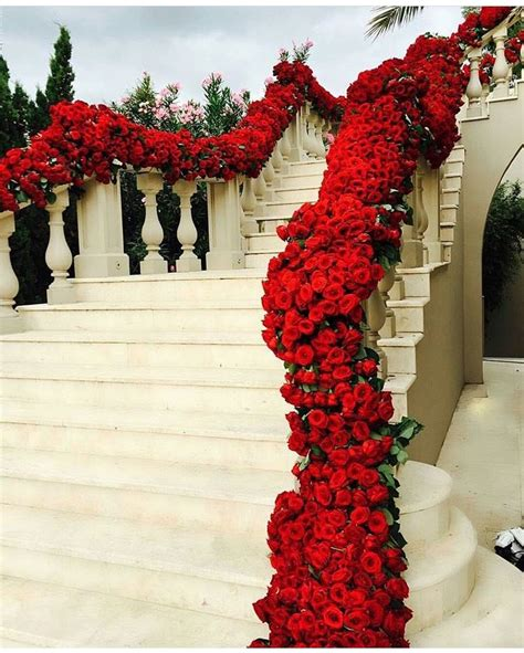 stunning floral wedding staircase decor  red roses