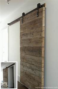 Salvaged plank custom barn doors rustic living room for Barnwood pocket door