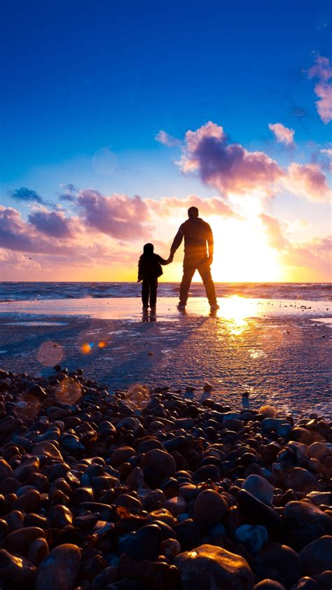 father  son  beach  sunset wallpaper