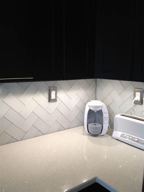 white glass subway tile herringbone pattern white glass subway tile and white quartz countertop added delorean gray