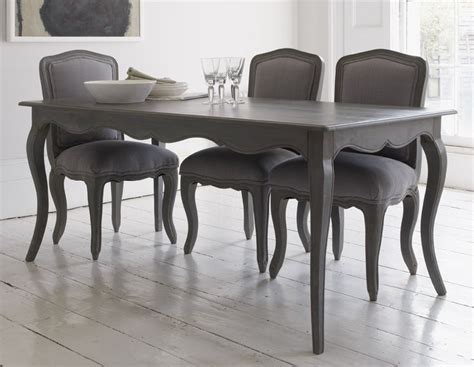 elegant dining table  curved legs  attractive detailing   matte storm grey wood finish