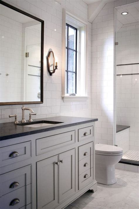 beautiful bathroom features full height subway tile