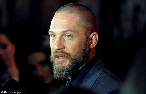 tom hardy unveils buzz cut  noomi rapace  child