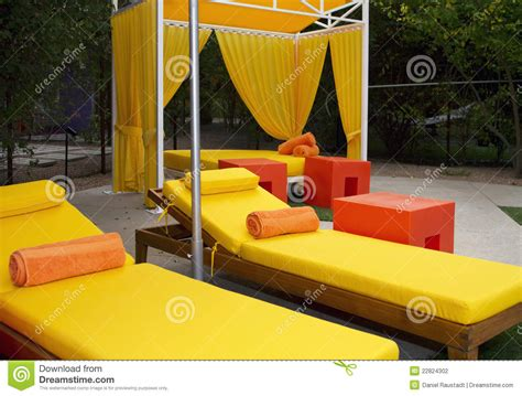 hotel swimming pool lounge chairs stock image