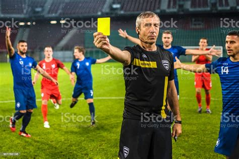 Yellow card stock photos (total results: Soccer Referee Showing Yellow Card Stock Photo & More Pictures of Adult - iStock