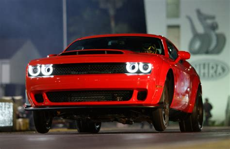 dodge demon runs  lifts  front wheels