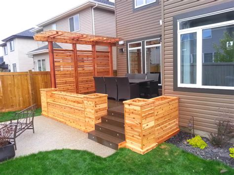 cedar planters with privacy screen and pergola craftsman