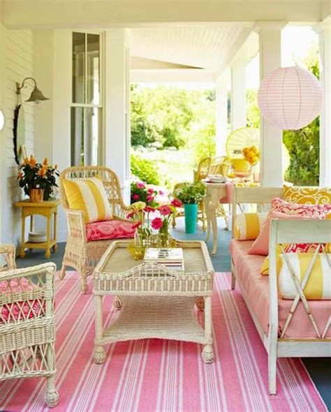 retro girly decor porch pink stripes rug rattan furniture