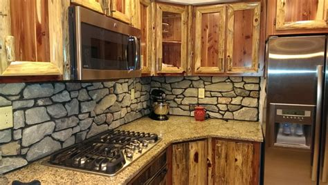 rustic red cedar kitchen  cultured stone backsplash