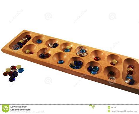 mancala board mancala board and stones royalty free stock image image 292726