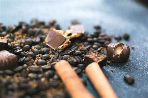 Last thematic week before all. Sweet Still Life. Coffee Beans, Chocolate Bars And Cinnamon Sticks. Stock Photo - Image of black ...