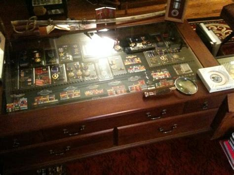 inspirations  glass top display case coffee table