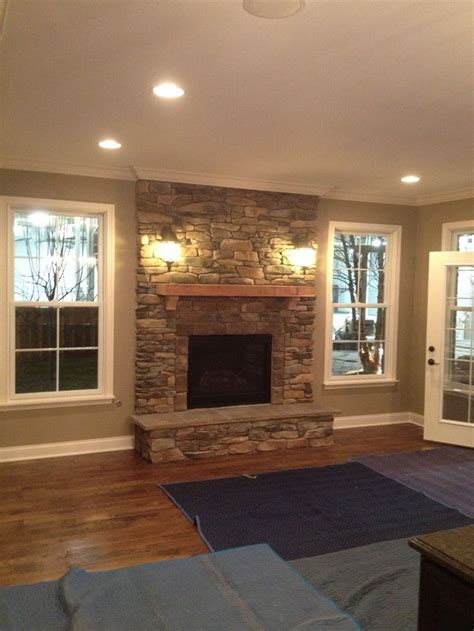 diy fireplace update with built in shelves on each place windows on each side and put window