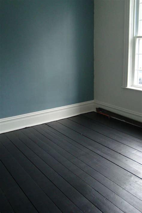 painted floorboards teal walls living room