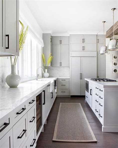 light gray cabinets warm gray cabinets natural fiber