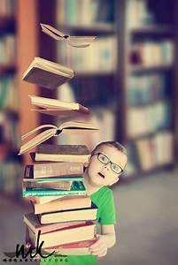 What an ADORABLE levitation photo! Love the floating books ...