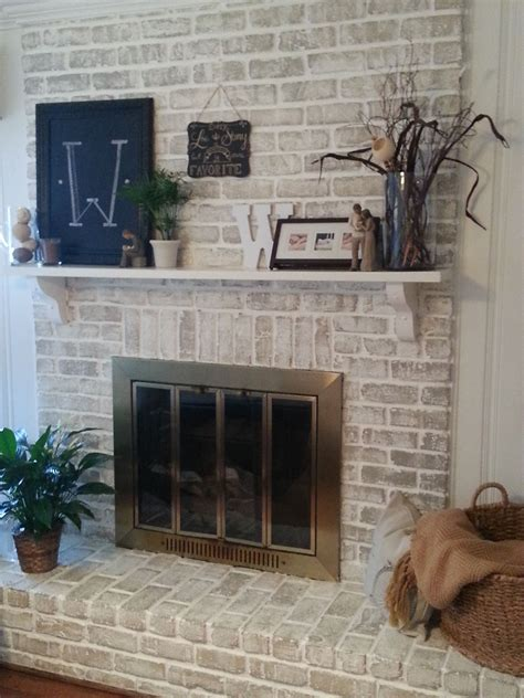 fireplace makeover     whitewashed    fireplace  painted white