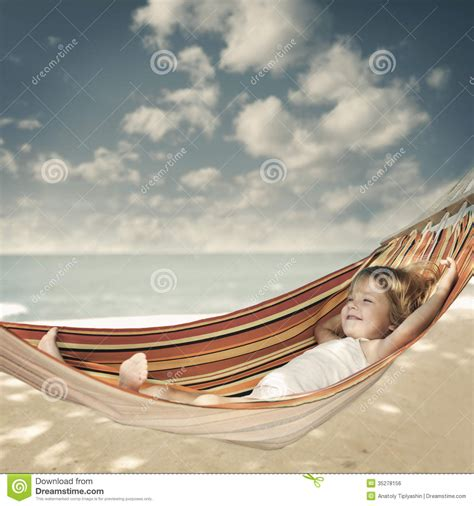 Relaxing In A Hammock by Child Relaxing In A Hammock Stock Photo Image Of Sleep