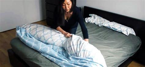 how to put on a duvet cover the duvet burrito how to put a duvet cover on your